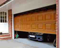 tan garage door opening with car numberplate showing slightly